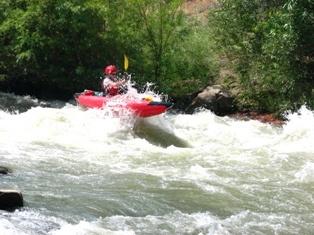 Beth kayaking catching air